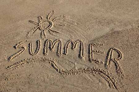 summer written in the sand at the beach Stock Photo