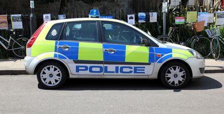 constabulary: A british police car parked on the side of the road. Could be used for editorial use related to police or law enforcement.