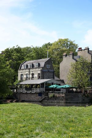Traditional stone riverside pub in Cambridge England Stock Photo