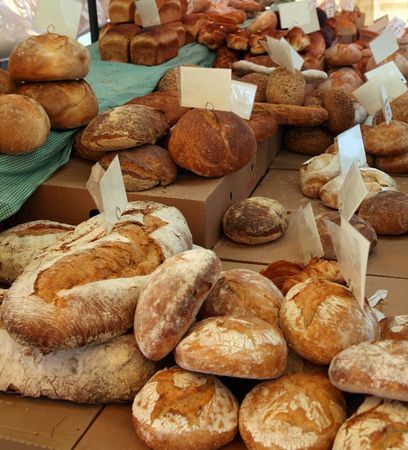 Many different types of bread for sale. photo