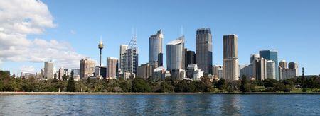 sydney skyline: Sydney City Skyline view across farm cove. Sydney is Australias largest city and a popular tourist destination.