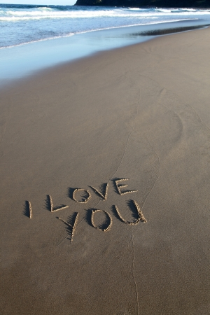 I love you written in the sand at the beach Stock Photo
