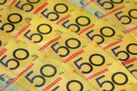 Closeup of many Australian 50 dollar notes. Shallow depth of field photo