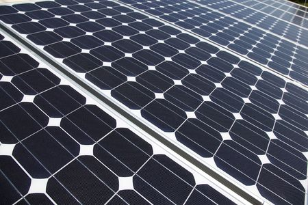 Closeup of solar panel cells mounted on roof top. Solar energy is becoming an important part of the energy mix. Stock Photo