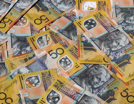 Closeup of many Australian 50 dollar notes. photo