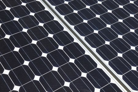 Closeup of solar panel cells mounted on roof top. Solar energy is becoming an important part of the energy mix. photo