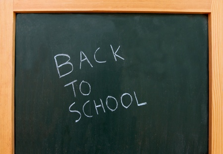 back to school written on a chalk board Stock Photo - 8433225