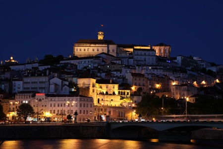 Night time photo of Coimbra cityscape. Coimbra is an historic university city in Portugal. The University was founded in 1290 and is one of the oldest in the world.