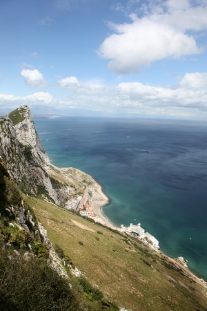 oversea: An view of The Rock of Gibraltar from the clifftop. Gibraltar is a oversea British Territory captured from Spain in 1704. It is located at the entrance to the Mediterranean Sea.