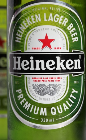 Newcastle, Australia - July 18, 2011: Green coloured Heineken beer bottles. Heineken beer is sold around the world and sponsors and number of famous sporting events.