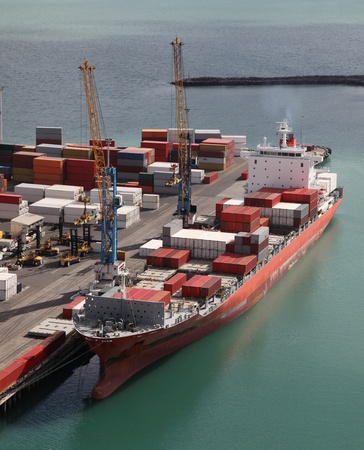 A container ship unloading at port in Napier - New Zealand