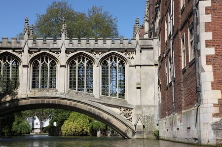 The Bridge of Sighs in Cambridge is a covered bridge and was built in 1831 and crosses the River Cam between the St John colleges Third Court and New Court. This image taken from a Punt on the river Cam. photo