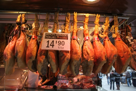 boqueria: Barcelona, Spain - March 30, 2009 - A butcher shop in the world famous, La Boqueria in Barcelona, Spain. Spain is renowned for cured and prepared meats such as Jamon and others shown here in this popular market. Editorial