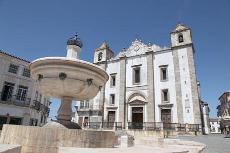 Giraldo Square in centre of Evora Portugal. The square dates from 1570 and features the Renaissance fountain (fonte Henriquina) and the  St Anton Church (Igreja de Santo Ant�o) photo