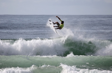 MEREWETHER AUSTRALIA - MARCH 15: Alan Jhones from Brazil does and aerial during competition in the Burton Toyota Pro at Merewether Beach. Mar. 15; 2012 Merewether; Australia.
