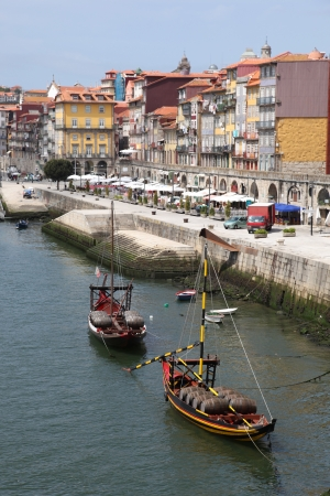 rabelo: A view of the Ribeira district and Douro River in Porto Portugal. This river front area is a popular tourist area.