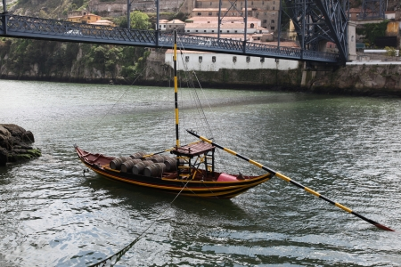 A traditional Rabelo boat on the Douro River - Porto - Portugal. Rabelo were traditionally used to transport barrels of port on the Douro river which is still famously known for. photo