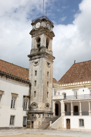 The main old university building and famous Clocktower at the University of Coimbra Portugal. The clock tower was constructed in the 18th century. The university was established in 1290 is one of oldest academic institution in the World.