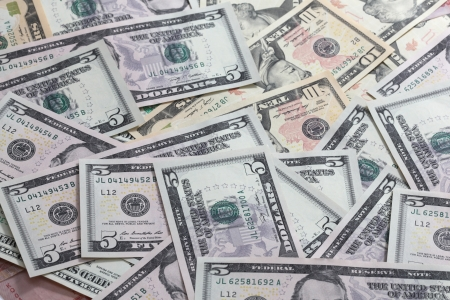 heap of dollar: A scattered pile of United States Paper five and ten dollar notes