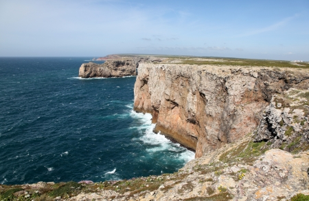 furthest: Rugged cliff line at Cape Saint Vincent - Sagres Portugal from the Lighthouse. This Cape is located at the furthest South West point on the Portuguese Coast. Stock Photo
