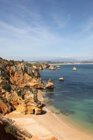cliff edges: Beautiful coastline and Praia do Camilo near Lagos in Portugal. Popular seaside area on Portugals southern coast.  Stock Photo