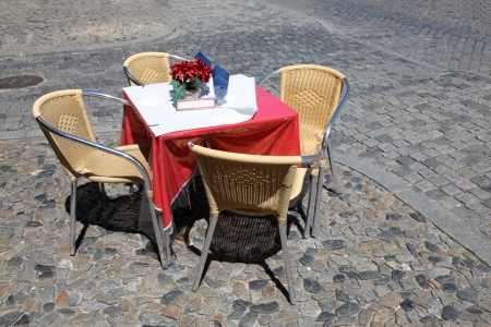 reserved seat: An outdoors Cafe Table with four chairs waiting for customers to arrive. Stock Photo