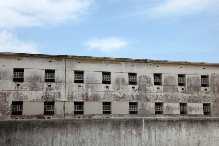 The windows of an abandoned prison in Peniche Portugal.