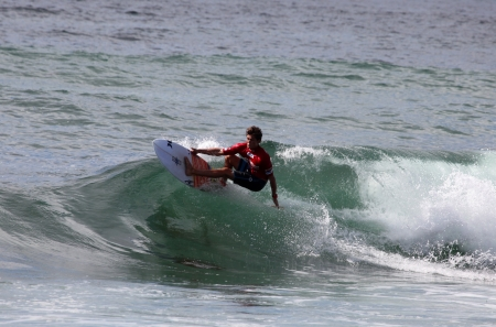 chapman: MEREWETHER AUSTRALIA - FEBRUARY 17: Cooper Chapman from Australia surfing in the Burton Toyota Pro Junior professional surfing event at Merewether Beach. Feb. 17, 2013 Merewether, Australia. Editorial