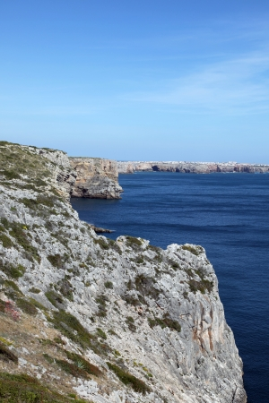 furthest: Rugged cliff line at Cape Saint Vincent - Sagres Portugal. This Cape is located at the furthest South West point on the Portuguese Coast. Stock Photo