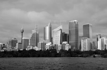 A black and white image of Sydney Skyline across farm cove on a moody day. Sydney is Australias largest city and a popular tourist destination. photo