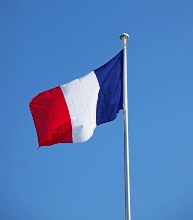 A French Flag flying in the wind photo