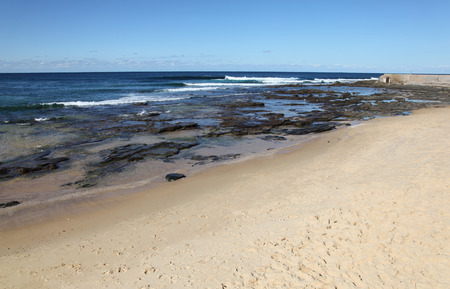 adjacent: A lovely day on the beach at the Cowrie Hole adjacent to Newcastle Beach Australia  Newcastle is Australia