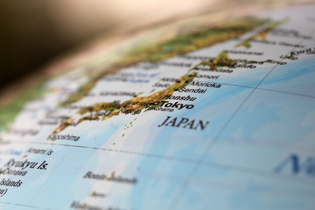 deliberate: Tokyo Japan on a world globe  Deliberate Shallow depth of field Stock Photo