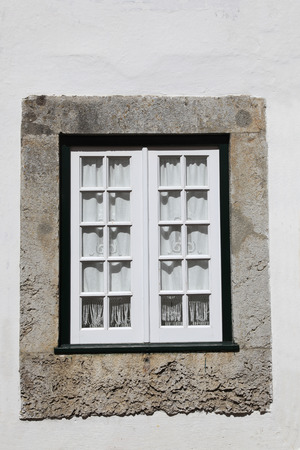panes: An ornate traditional style window in Portugal
