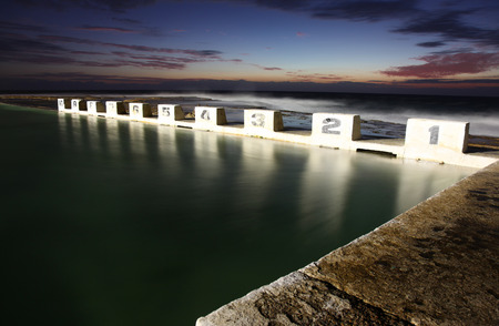 Merewether Ocean Baths at dawn showing the iconic starting blocks of this Newcastle landmark  photo