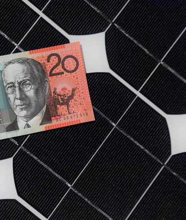 Solar Panels and Australian twenty dollar note demostrating the link between solar generation and electricity bills  photo