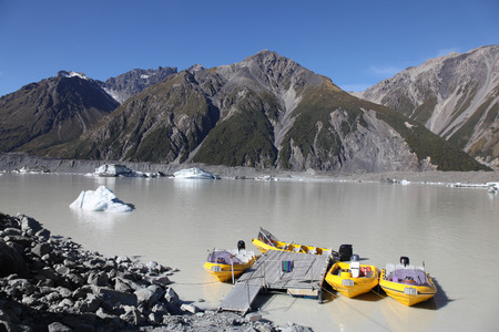 tasman: Tasman Lake is at the terminal of Tasman Glacier in New Zealand  The lake is one of the few in the world where tourists can cruise up close to ice burgs formed from a glacier  Stock Photo