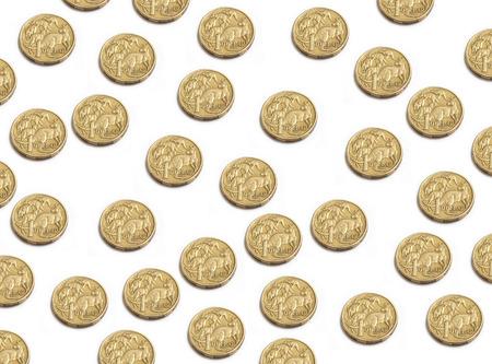 randomly: Australian Dollar coins randomly placed isolated on white