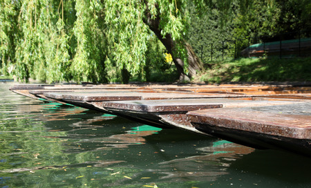 cambridgeshire: Punts on the river Cam - Cambridge. This famous English university town is renowned for punting on the river that flows through the town