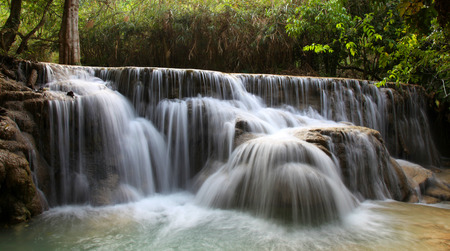 cool off: A small waterfall at the Kuang Si Falls outside of Luang Prabang. These waterfalls and cascades are a popular place for tourists and locals to visit to cool off.