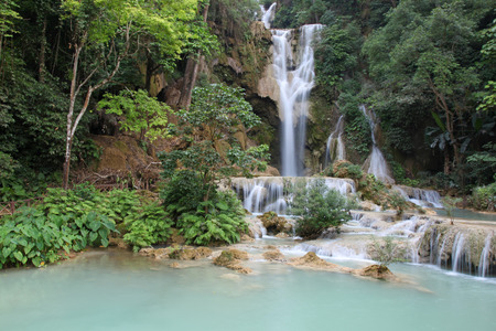 cool off: A  waterfall at the Kuang Si Falls outside of Luang Prabang. These waterfalls and cascades are a popular place for tourists and locals to visit to cool off.  Luang Prabang - Laos Stock Photo
