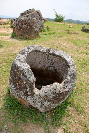 however: Plain of Jars, Phonsavan, Laos. These megalithic stone jars located on the plains around Phonsavan, their use is unknown however some theories that they were used for burial purposed. Stock Photo