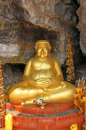 venerable: Fat Buddha Statue in Luang Prabang Laos.  Buddhism is an integral part of life in UNESCO listed town of Luang Prabang in Laos