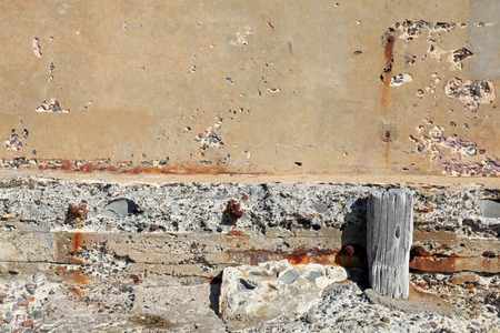 crumbling: A weathered and crumbling concete wall