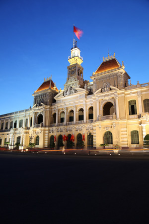 city building: The peoples committee building is a popular landmark in Ho Chi Minh City Vietnam. This building is an example of the colonial French past of this Asian Nation.