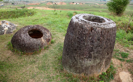laos: Plain of Jars, Phonsavan, Laos. These megalithic stone jars located on the plains around Phonsavan, their use is unknown however some theories that they were used for burial purposed. Stock Photo