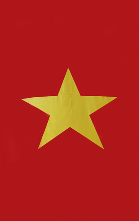 yellow star: Closeup of Vietnamese flag and its yellow star.