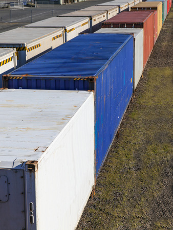 goods train: A freight train loaded with containers transporting goods across the country Stock Photo