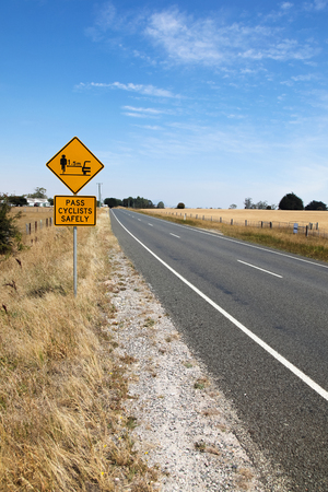 widespread: A cycling safety sign on the side of the road in Tasmania - Australia. Cycling in Tasmania is a popular pursuit and road safety campaigns are becoming more widespread.