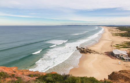 Redhead Beach south of Newcastle is a popular surfing beach. This elevated view shows the beach running down towards Blacksmiths Beach and Swansea. Фото со стока - 91201929